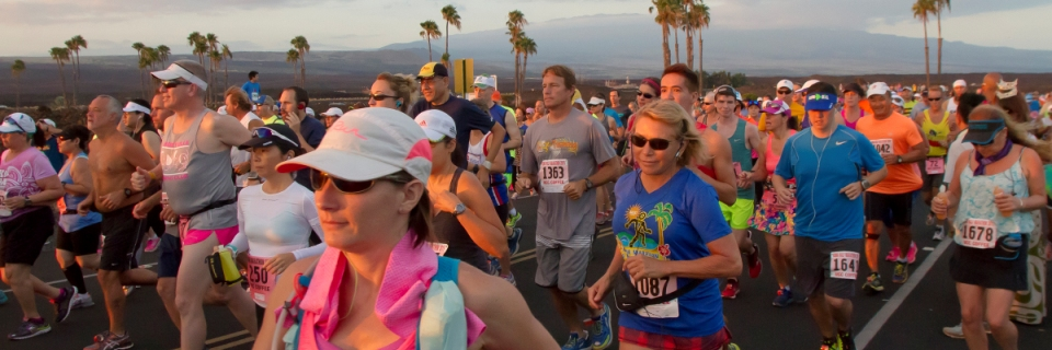 A group of runners take off at the start of the Kona marathon and half-marathon races. (Rick Winters/West Hawaii Today)